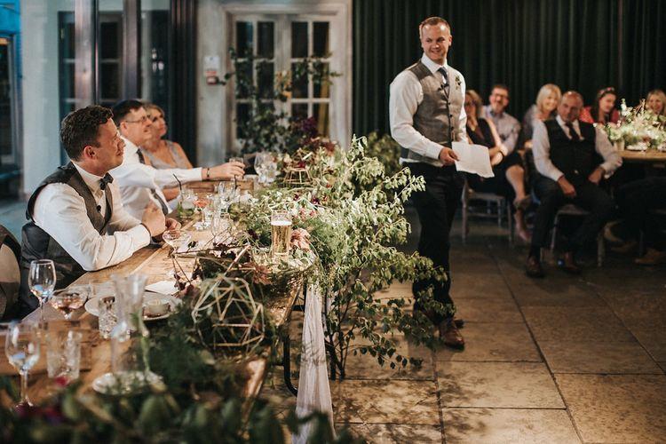 Wedding Reception Groom Speech with Greenery Top Table Decor