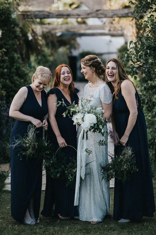 Bridal Party Portrait with Bridesmaids in Navy Dresses and Hoop Bouquets and Bride in Beaded Jenny Packham Nashville Wedding Dress