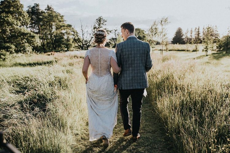 Bride in Backless Beaded Jenny Packham Nashville Wedding Dress and Groom in Grey Check Blazer