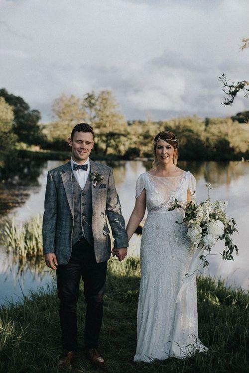 Bride in Beaded Jenny Packham Nashville Wedding Dress and Groom in Grey Check Blazer and Waistcoat