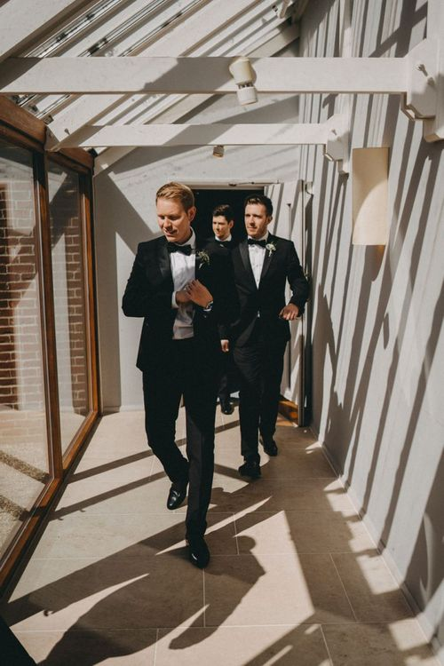 Groom and groomsmen in classic black tuxedos