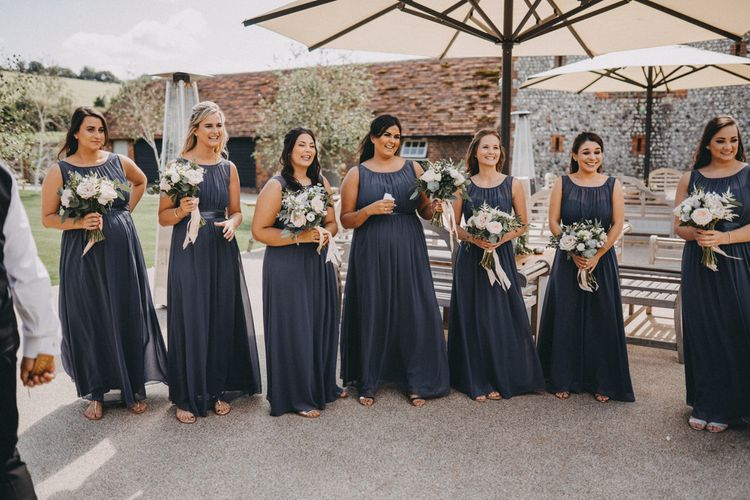 Grey bridesmaid dresses at Farbridge wedding venue