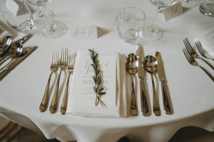 Wedding table place setting with herb decor