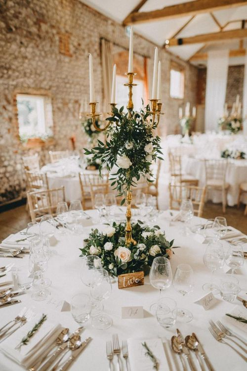 Tall floral wedding centrepiece with candelabra