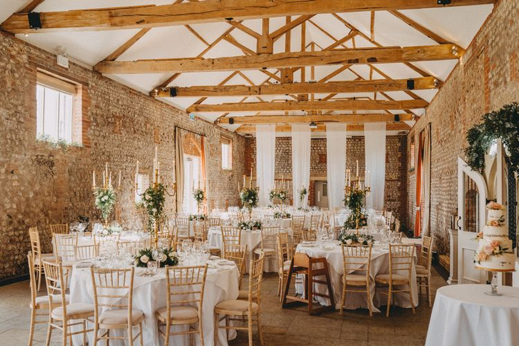 Farbridge wedding venue with tall centrepieces on table of rustic barn
