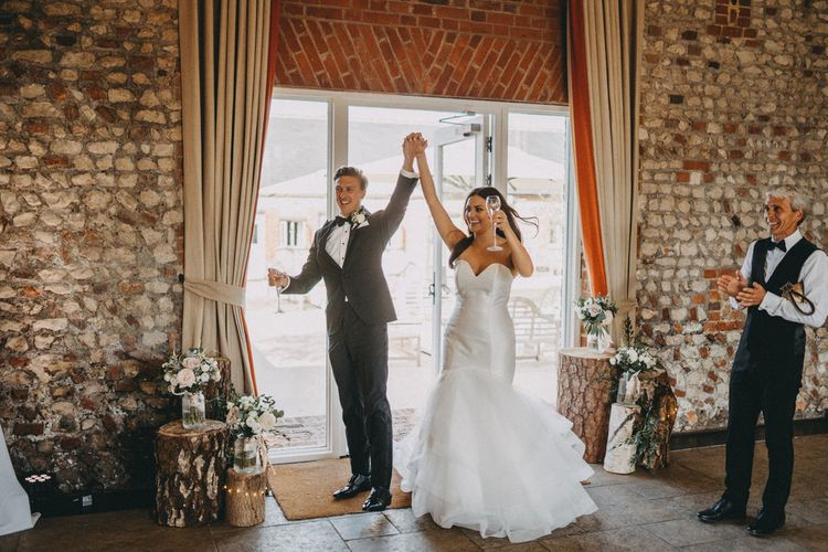 Bride and groom enter Farbridge wedding venue reception