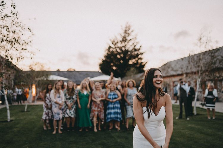 Bride gets ready to throw her bouquet to guests