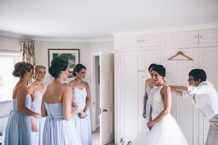 Wedding Morning Preparations | Beaded Halterneck Bridal Gown with Tulle Skirt and Spaghetti Straps by Maggie Sottero | Pastel Blue Bridesmaids Dresses from ASOS | Halterneck Maggie Sottero Dress and Garden Games at Gate Street Barn | Story + Colour Photography