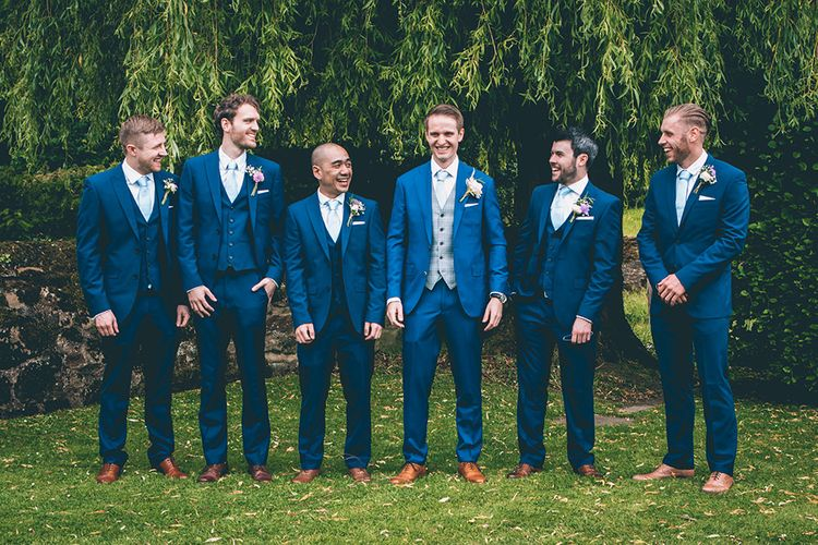 Groom in Royal Blue Suit from Suit Supply and Tan Brogues from Barker | Groomsmen in Navy Blue Suits with Pastel Blue Ties | Halterneck Maggie Sottero Dress and Garden Games at Gate Street Barn | Story + Colour Photography