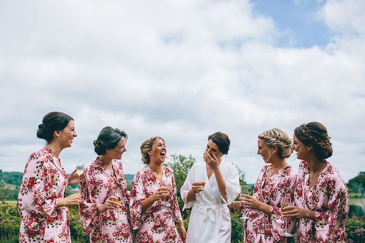 Wedding Morning Preparations | Bride in White Getting Ready Robe | Bridesmaids in Pink Floral Getting Ready Robes | Halterneck Maggie Sottero Dress and Garden Games at Gate Street Barn | Story + Colour Photography