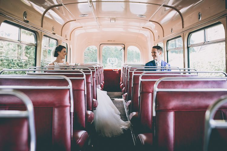 Retro Wedding Bus | Bride in Beaded Halterneck Gown with Tulle Skirt and Spaghetti Straps by Maggie Sottero | Groom in Royal Blue Suit from Suit Supply and Tan Brogues from Barker | Halterneck Maggie Sottero Dress and Garden Games at Gate Street Barn | Story + Colour Photography