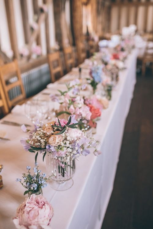 Wedding Reception Decor | Top Table | Pastel Flowers | Halterneck Maggie Sottero Dress and Garden Games at Gate Street Barn | Story + Colour Photography