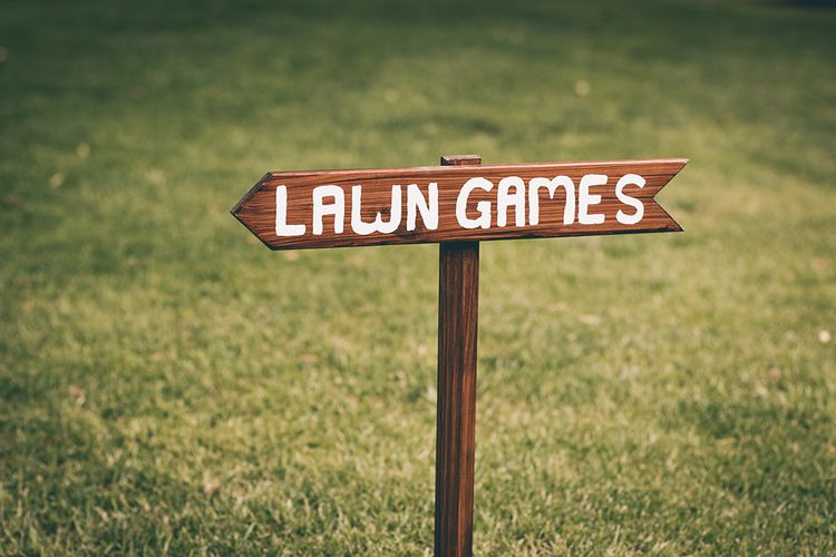 Wedding Reception Decor | Lawn Games Sign | Halterneck Maggie Sottero Dress and Garden Games at Gate Street Barn | Story + Colour Photography