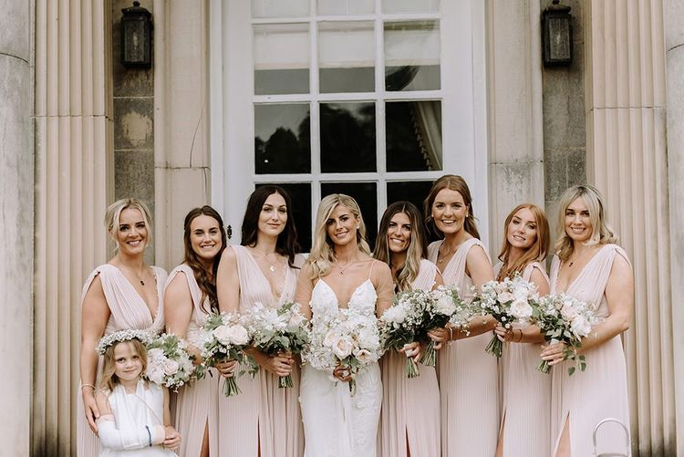 Bridal Party in Pink Bridesmaid Dresses Holding Blush Bouquet