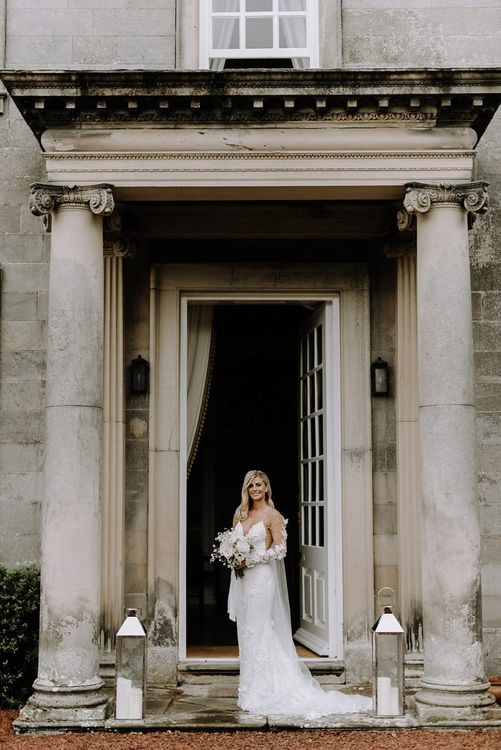 Bride in Riki Dalal Applique Wedding Dress with Sleeves