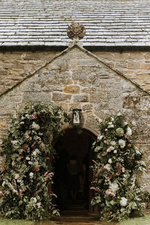 Church Entrance Surrounded with Floral Decor