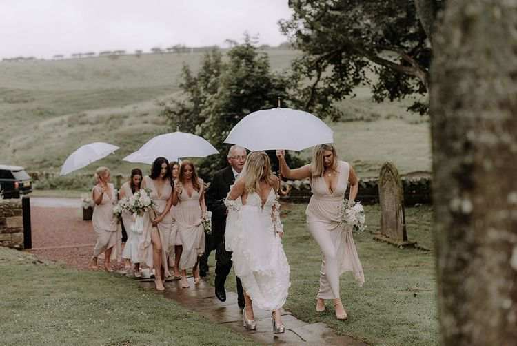 Bridal Party Arriving at Church in Rain with Umbrellas