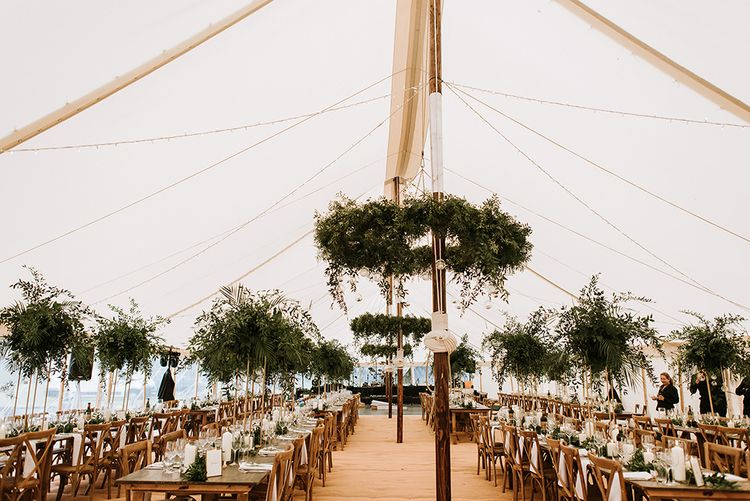 Tent Wedding With Foliage Table Decor and Hanging Decoration
