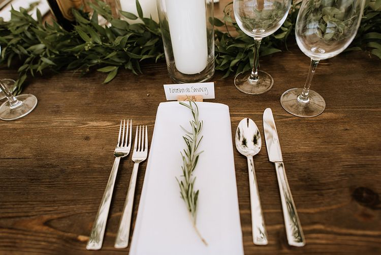 Table Setting with Herbs and Candle