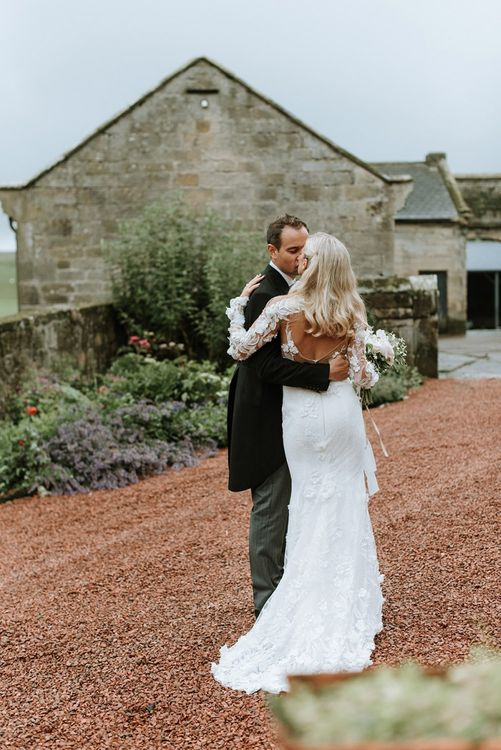 Bride and Groom with Low Back Riki Dalal Dress