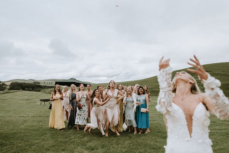 Bride Throws Bouquet to Wedding Party