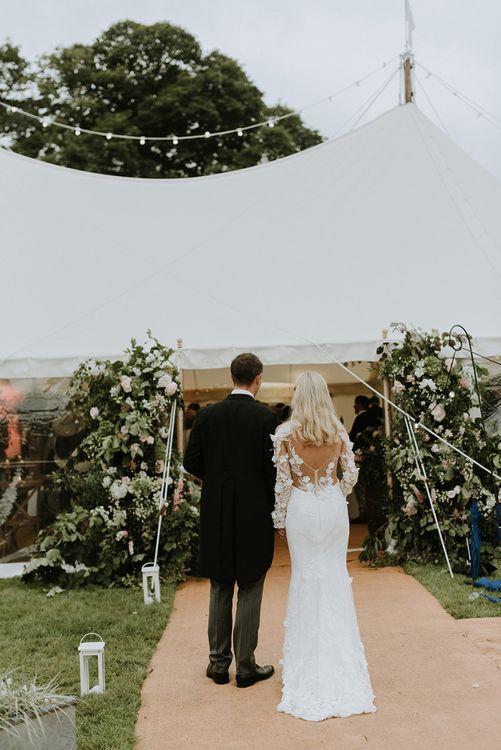 Bride and Groom Entering Reception Tent