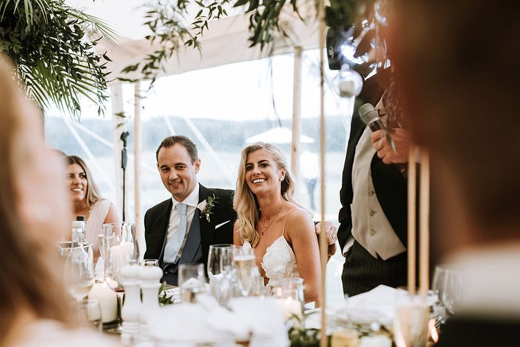 Bride and Groom on Top Table during Speeches with Floral and Foliage Decoration