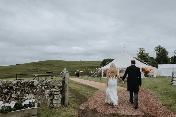 Bride and Groom in Front of Tent