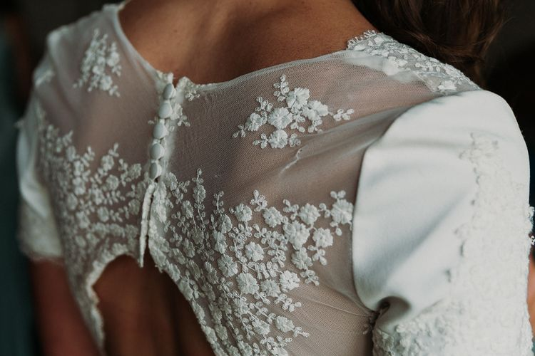 Pre-loved Rime Arodaky wedding dress with lace back details for DIY stretch tent wedding