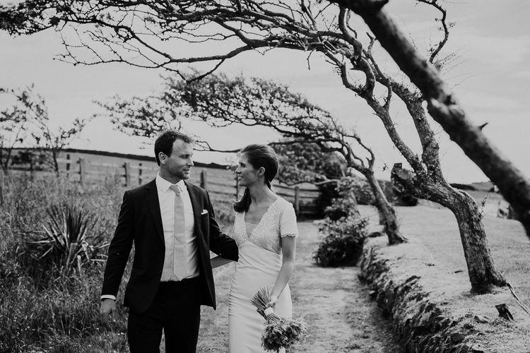 Bride in Rime Arodaky wedding dress and groom in bespoke suit
