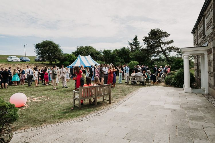 stretch tent wedding ceremony and marquee reception at Roscarrock Farm in Cornwall