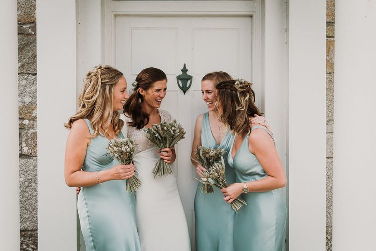 Bridal Party in pale green Ghost bridesmaid dresses and Pre-owned Rime Arodaky wedding dress