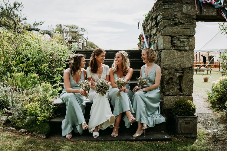 bridal party portrait at stretch tent wedding ceremony and marquee reception in Cornwall