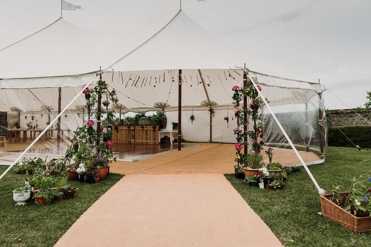 stretch tent ceremony and marquee reception with rustic DIY decor