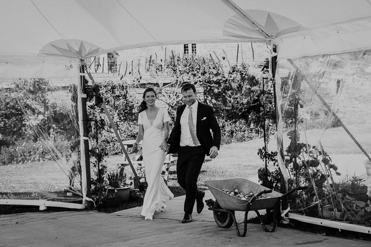 Bride and groom entering the stretch tent wedding reception