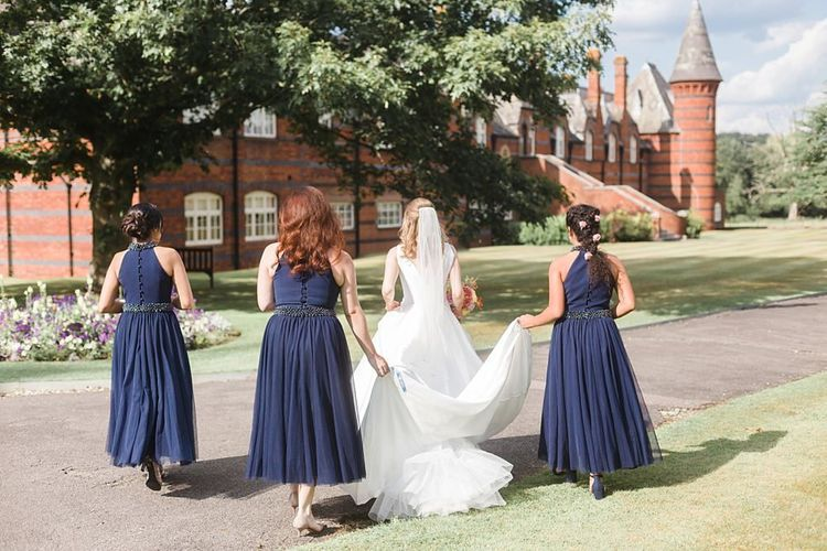 Navy bridesmaid dresses at fusion wedding before changing outfits for Hindu wedding ceremony