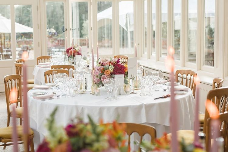 Amazing bright wedding flowers and table decor