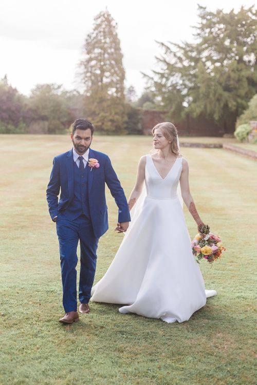 Suzanne Neville bride dress with bright bouquet