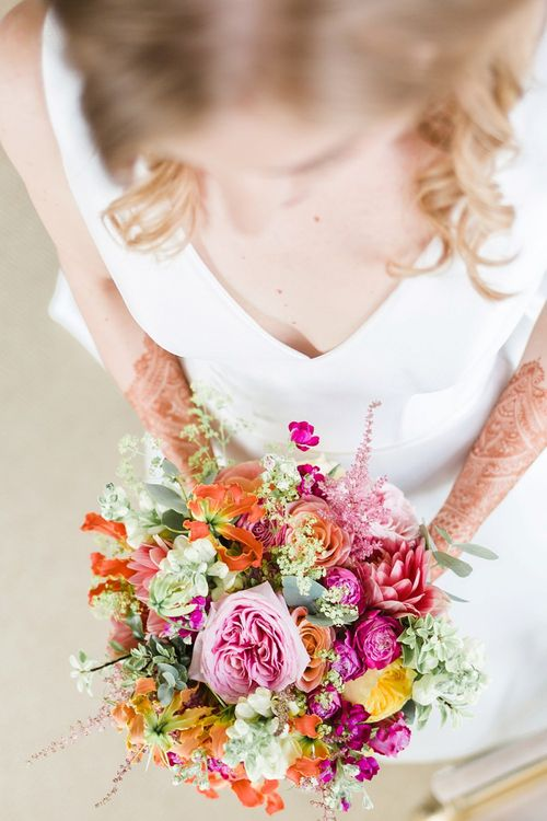 Bright wedding flowers at English wedding with Hindu wedding ceremony