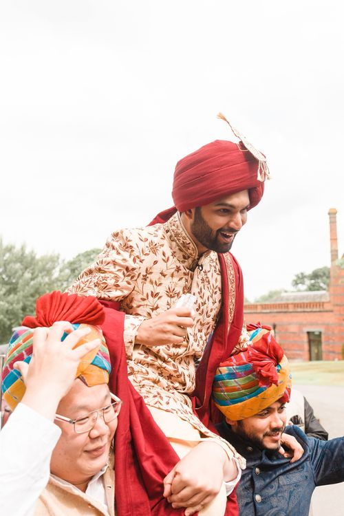 Groom is carried into traditional Hindu wedding ceremony