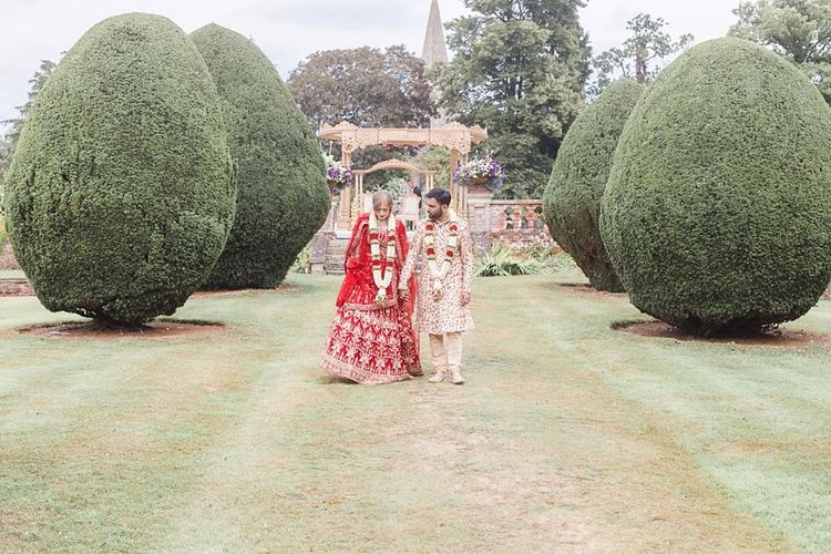 Bride wears traditional Indian wedding dress in red and gold