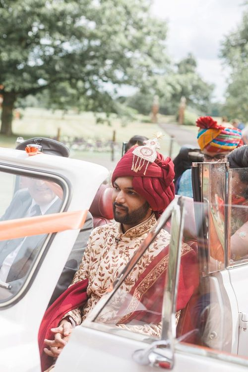 Groom arrives at Hindu wedding ceremony in traditional clothing