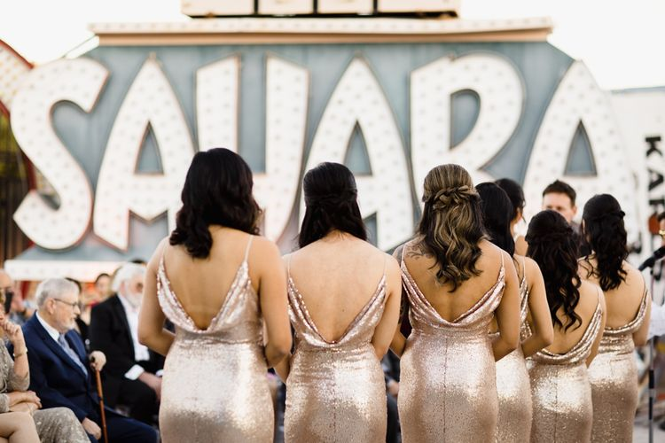 Bridesmaids in Gold Sequin Maxi Dresses with Cowl Back | Wedding Ceremony at The Neon Museum | Las Vegas Wedding with Gold Sequin Bridesmaids Dresses and Silk Flowers | Chris Barber Photography
