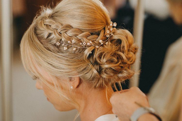 Braided undo for bride at Upwaltham Barns wedding