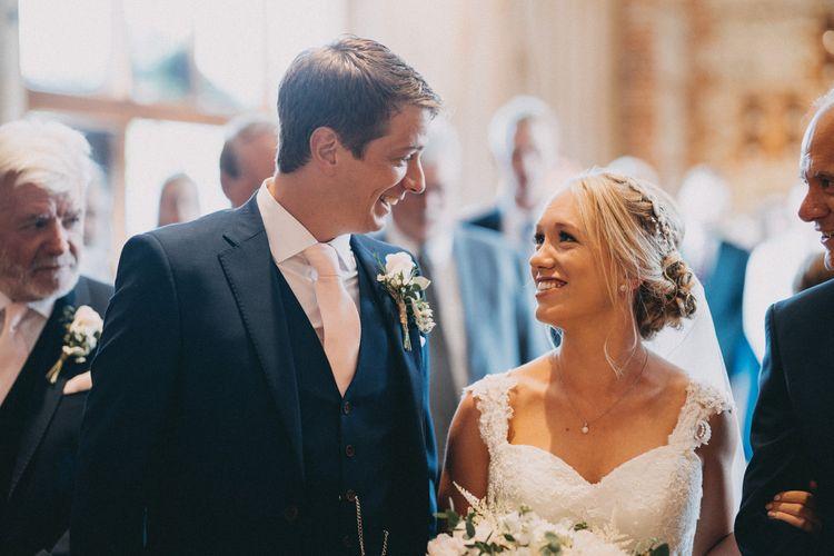 Bride sees groom at altar at Upwaltham Barns