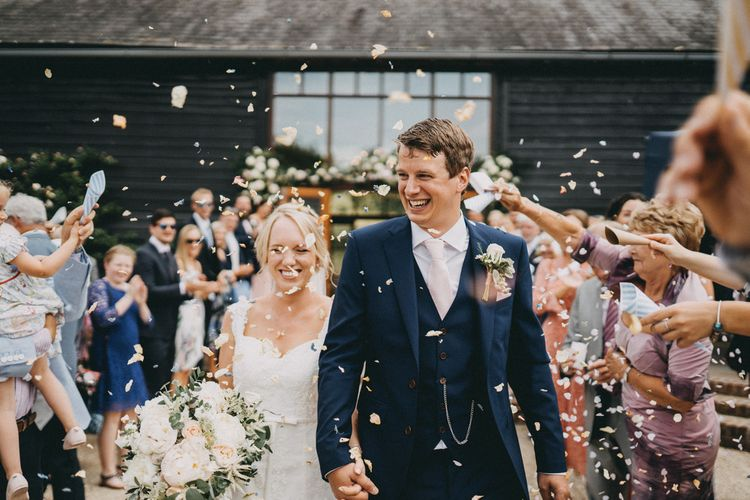 Confetti exit for bride and groom at Upwaltham Barns