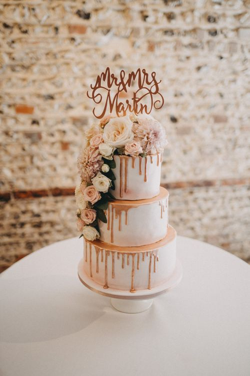 Drip wedding cake with flowers and personalised cake topper