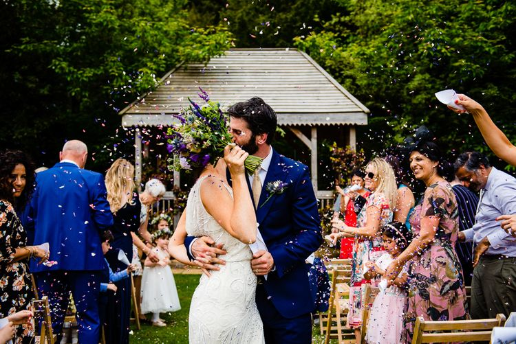 Pennard House Wedding With Outdoor Ceremony Bride In Phase Eight Groom In Savile Row Suit And Bridesmaids In Ghost Images By Jonny Barratt Photography
