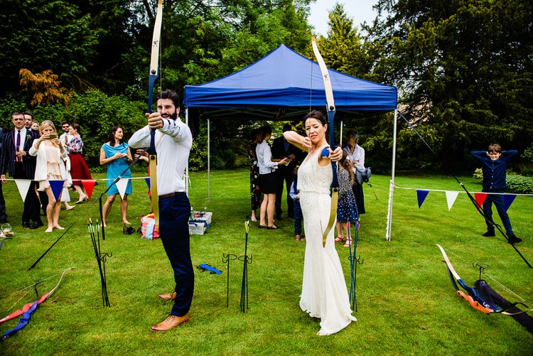 Archery Wedding Entertainment // Pennard House Wedding With Outdoor Ceremony Bride In Phase Eight Groom In Savile Row Suit And Bridesmaids In Ghost Images By Jonny Barratt Photography