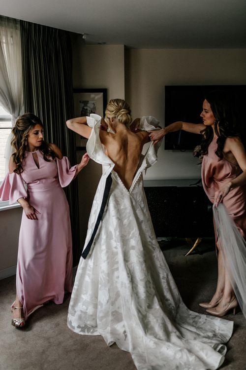 Bride Getting into a Jesus Peiro Crisalida Wedding Dress